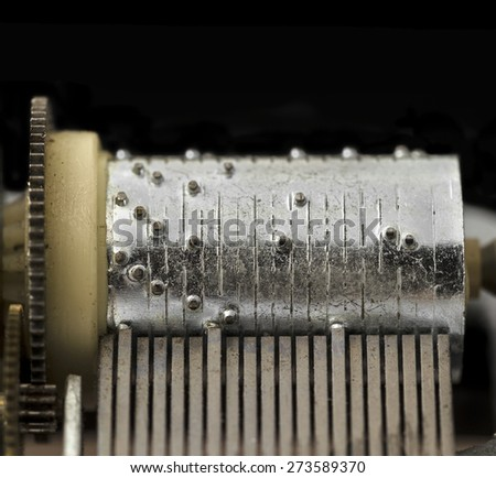 Old music box cylinder and pins - stock photo
