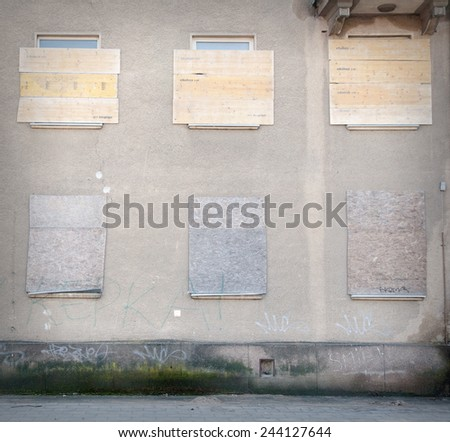 Old nailed windows on the wall - stock photo
