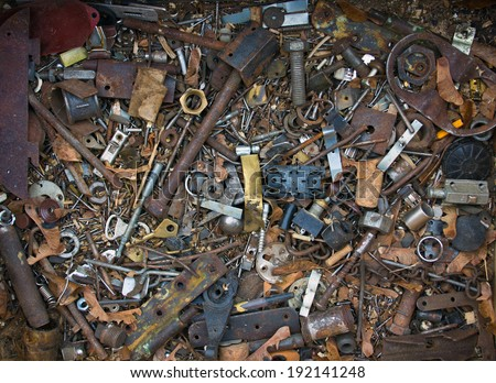 Old nails, screws and plugs in different types and sizes. - stock photo