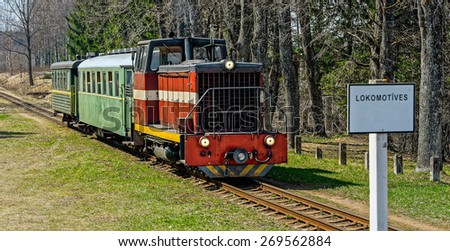 Old narrow-gauge railway. Passenger train with diesel locomotive. Latvia. - stock photo