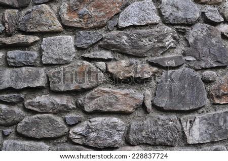 Old natural stone wall - stock photo
