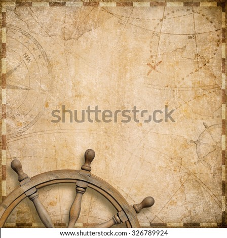 old nautical map with steering wheel - stock photo