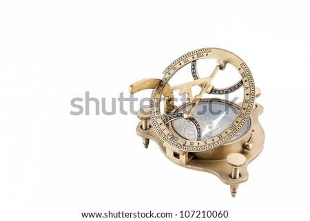 Old nautical sundial compass isolated in a white background - stock photo