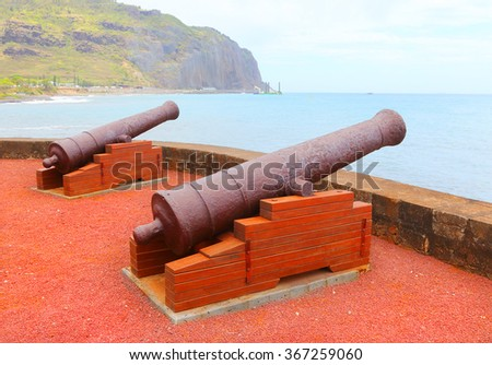 Old navy cannons on waterfront in Saint-Denis, Reunion Island. - stock photo