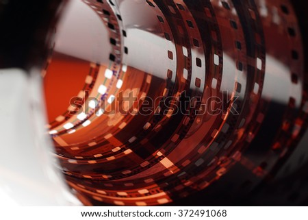 Old negative 35 mm film strip on white background, strip of tangled camera film - space for copy and text - stock photo