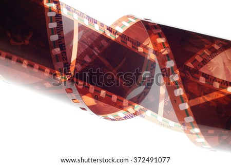 Old negative 35 mm film strip on white background, strip of tangled camera film - space for copy and text
