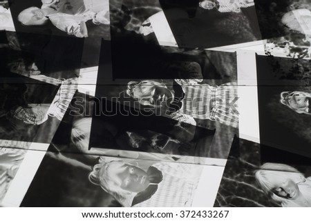Old negative 35 mm film strip on white background, strip of tangled movie film - place for copy and space text