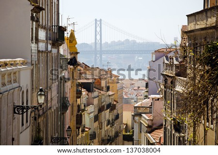 Old neighborhood and bridge in the background, Lisbon, Portugal - stock photo