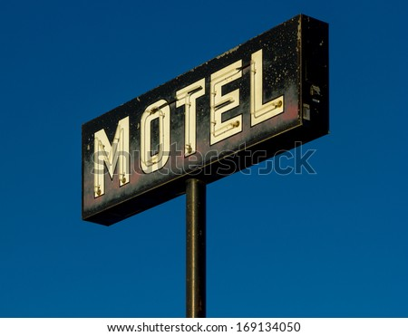 Old neon Motel sign - stock photo