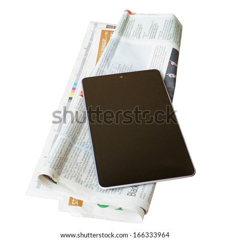 old newspapers and a tablet pc isolated on white background - stock photo
