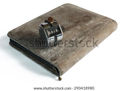Old notebook's cover Isolated on White with Hand Counter. - stock photo