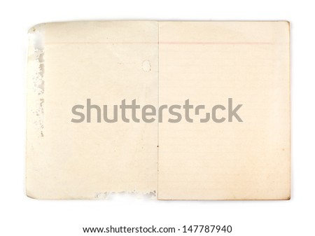 Old notebook with hole on white background - stock photo