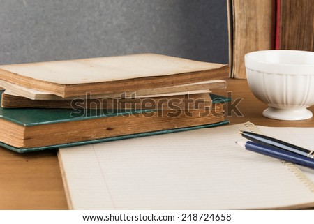 old notebook with pen on wood table - stock photo