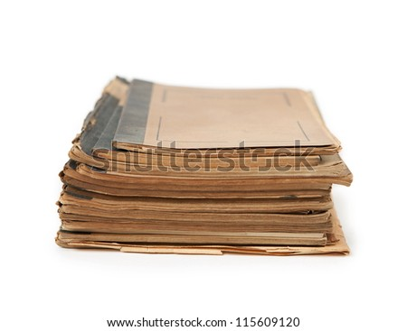 Old notebooks (1940-50s) stacked, and isolated on white. Blank cover.
