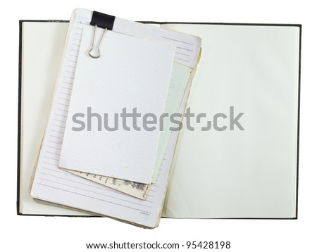 Old notepad and documents on opened notebook - stock photo