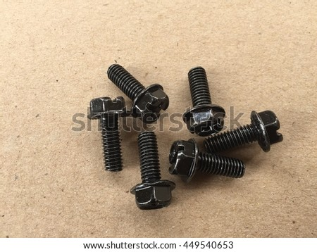 Old nut and bolt  on brown paper background with copyspace