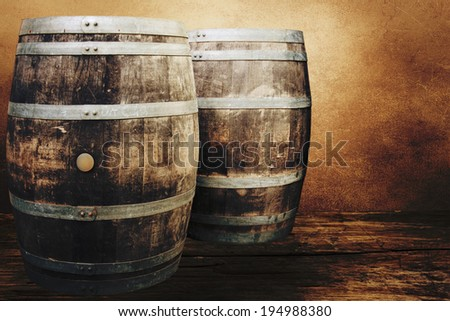 Old oak barrels on the wall background.  - stock photo