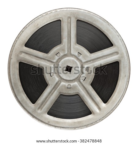 Old obsolete film reel isolated on white