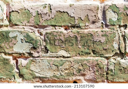 Old obsolete painted brick wall - stock photo