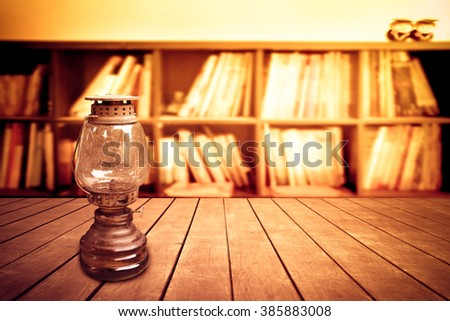 old oil lamp with blur book shelf background