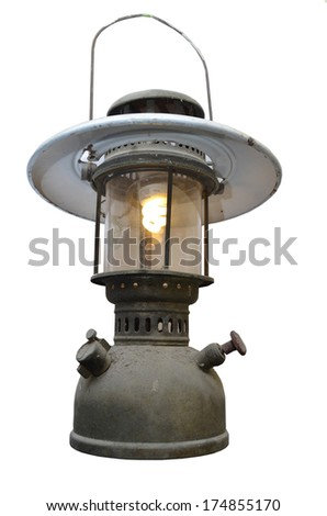 Old oil lamp with idea electric light inside on white background - stock photo
