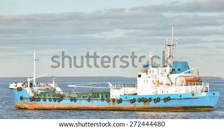 Old oil products tanker in the sea. - stock photo