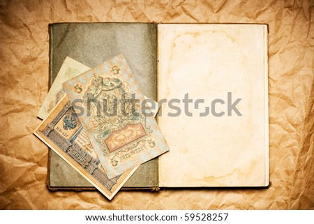 old open blank book and ancient russian money - stock photo