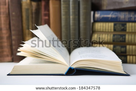 Old Open book in  Library - stock photo