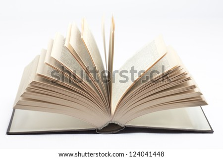 Old open book on white background with the pages open