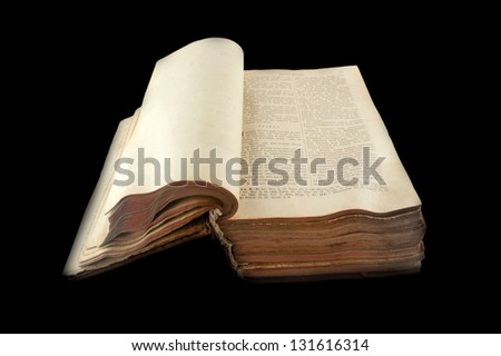 old open Russian bible isolated on black background - stock photo