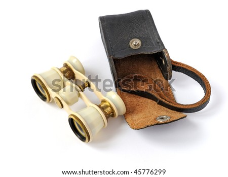 old opera glasses with a leather handbag on white background - stock photo