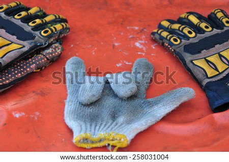 Old or dirty safety gloves on the works. - stock photo