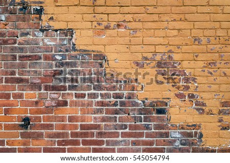 Old Orange Exterior Brick Wall with a Pattern of Stairs