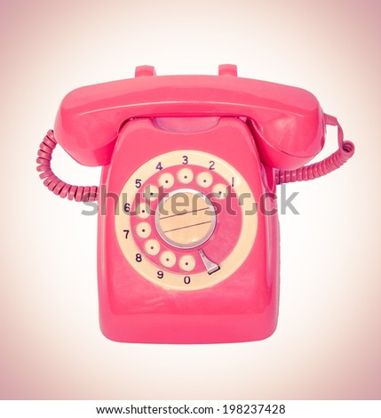old orange telephone with rotary dial in vintage - stock photo