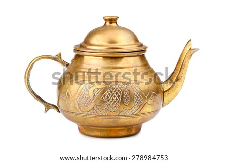 Old oriental metallic teapot on a white background