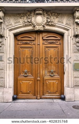 Old ornate door in Paris, France - typical old apartment building. - stock photo
