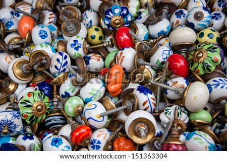 Old ornate knobs background. - stock photo