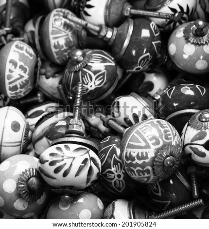 Old ornate knobs background. Closeup. Aged photo. Black and white. - stock photo