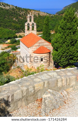 Old orthodox monastery surrounded by Mediterranean vegetation - stock photo