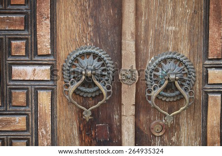 Old Ottoman style wooden door and knocker in Eyup, Istanbul. - stock photo