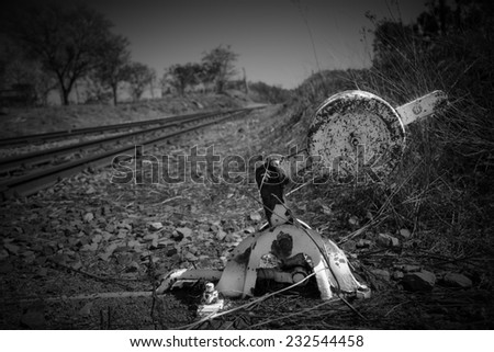 Old overgrown used railway track switch mechanism in artistic conversion - stock photo