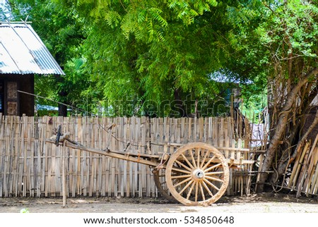Old ox cart in front of  a burmese house