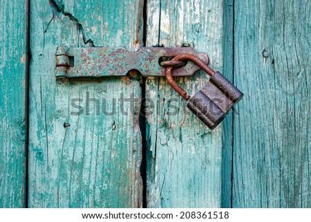Old padlock closeup. - stock photo