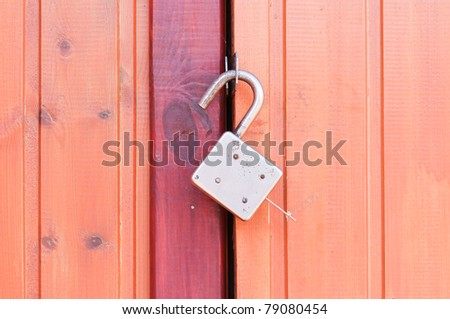 Old padlock on garage collars