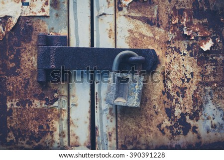 old padlock on rusty door, locked vintage door  - stock photo