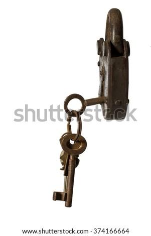 old padlock with key on white background close-up  - stock photo