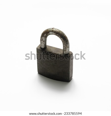 old padlock with rust on a white background - stock photo