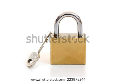 Old padlock with the key on white background - stock photo