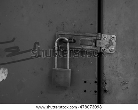 Old Padlocked, black and white tone, abstract dark feeling background