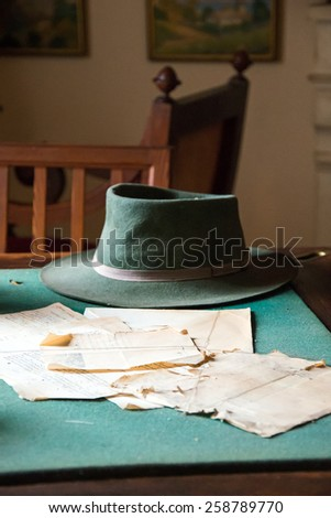 Old pages from books on the dusty table. - stock photo